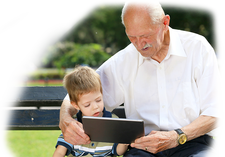 an older man watching something on tablet with child